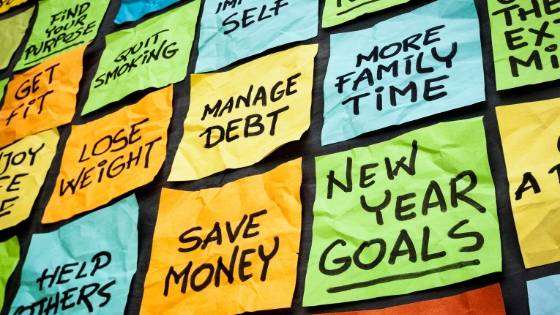 Sticky notes with personal and business goals.