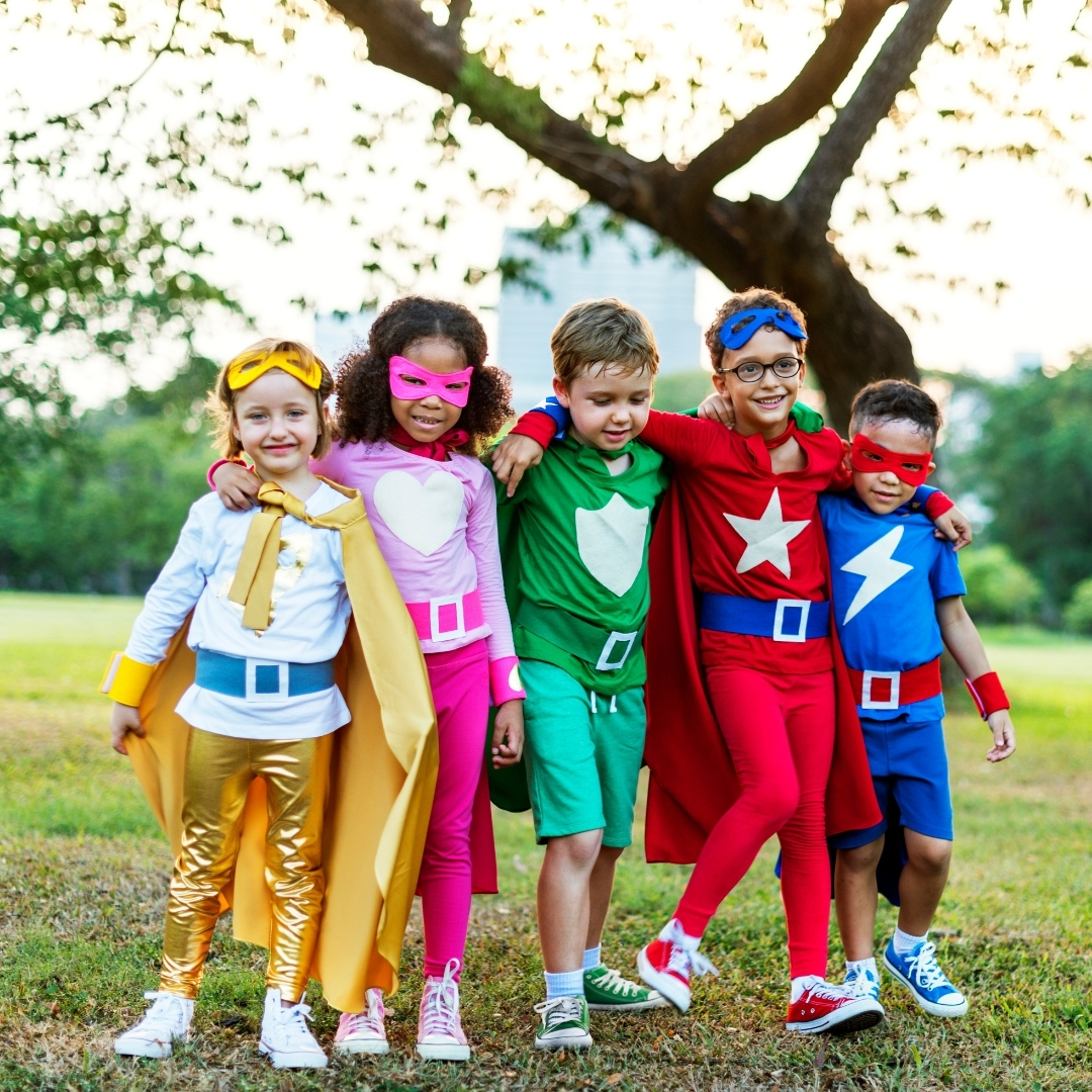 Group of kids dressed as action hero.